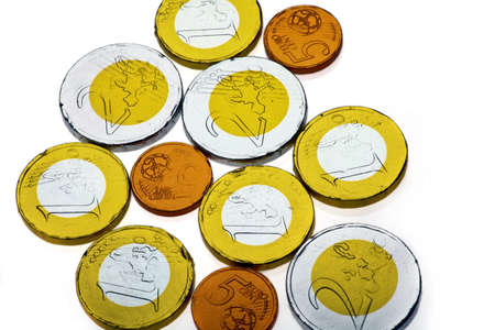 Chocolate sweets imitating various Euro coins, on white Stock Photo - 17640816