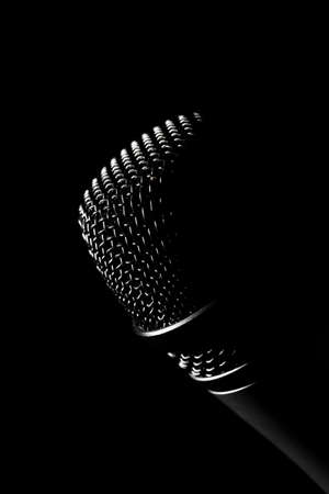 Studio shot of a microphone, on black