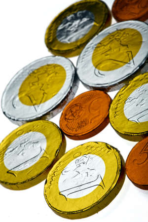 Chocolate sweets imitating various Euro coins, on white. Stock Photo - 17779960