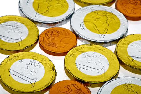 Chocolate sweets imitating various Euro coins, on white. Stock Photo - 17779963