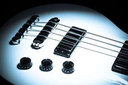 single songs: Dark shot of an electrical bass guitar Stock Photo