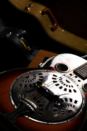 resonator: Color shot of a vintage guitar in a case