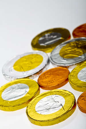 Chocolate sweets imitating various Euro coins, on white. Stock Photo - 18264537