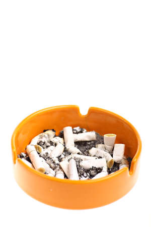 Detail of an orange ashtray with many burnt cigarettes. photo