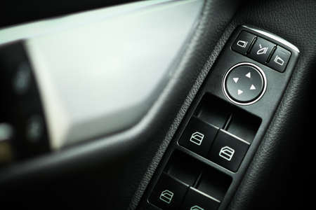 Detail on buttons controlling the windows in a car photo