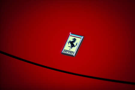 Bucharest, Romania - April 4, 2013: Ferrari logo is displayed on a cars hood in Bucharest. Ferrari is an Italian sports car manufacturer based in Maranello, Italy.