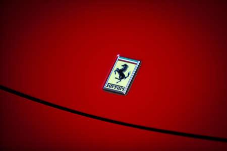 Bucharest, Romania - April 4, 2013: Ferrari logo is displayed on a car's hood in Bucharest. Ferrari is an Italian sports car manufacturer based in Maranello, Italy.