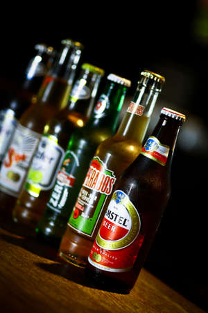 Bucharest, Romania - May 2, 2013: Close-up shot of a row of various beer bottles among which Amstel, Desperados, Zipfer, in a pub.  Stock Photo - 19415936