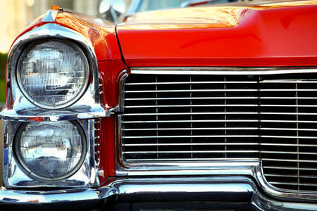 car grill: Color detail on the headlight of a vintage car