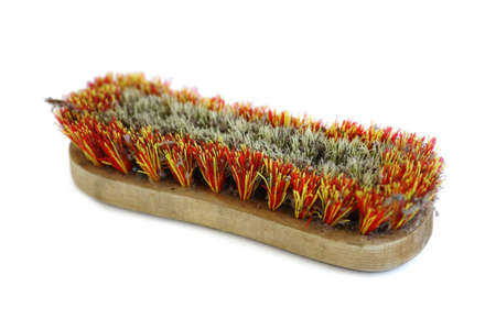 Close-up shot of a scrub brush isolated on white photo