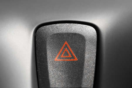 Detail of a warning button in a car photo