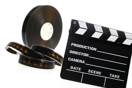 cinematic: A black film case reel and a cinema clap isolated on white Stock Photo