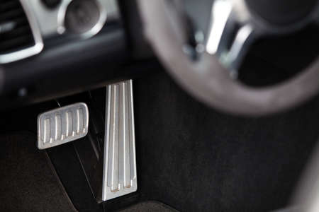 Brake and accelerator pedals in a car Stock Photo
