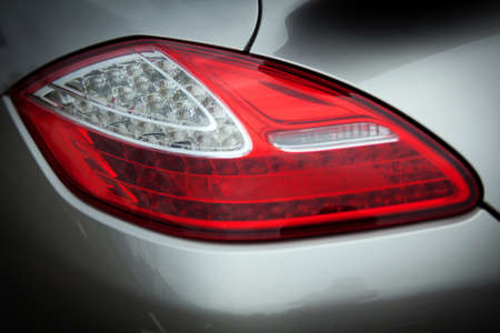 Detail on the rear light of a gray car