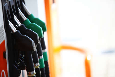 Horizontal shot of some fuel pumps at a gas station