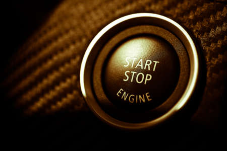 Detail on the start button in a car photo