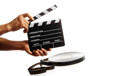film industry: Two hands holding a cinema clap isolated on white