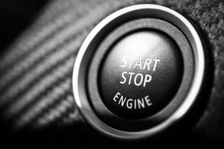 car engine: Detail on the start button in a car