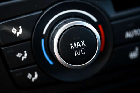 cooling: Color detail with the air conditioning button inside a car Stock Photo