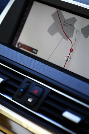 Vertical shot of a navigation system in a car photo