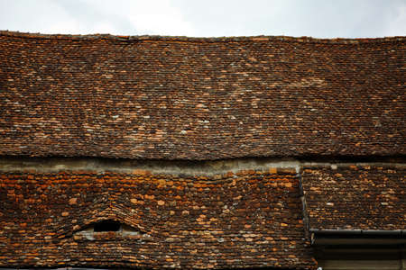 Picture of some old roof with tiles photo