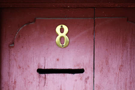 Color shot of a mail slot in an old door. photo