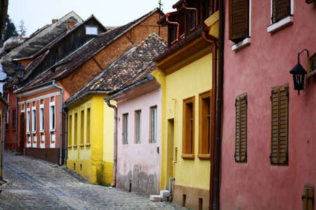 View of a narrow street in the medieval town of Sighisoara, Romania. photo
