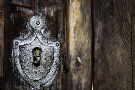 ancient prison: Detail of a vintage lock system and a keyhole