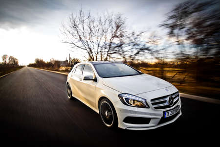 cars on road: Bucharest, Romania - March 19, 2013: A Mercedes-Benz A 200 Sport AMG Line is pictured on a roasd in Bucharest, Romania. The A-Class is a small family car, produced by the German automobile manufacturer Mercedes-Benz. Editorial