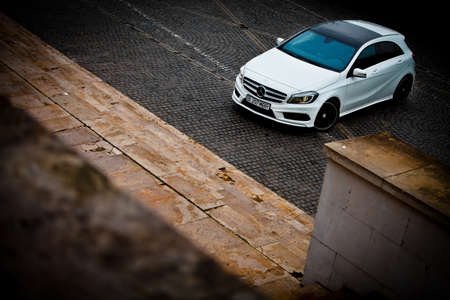 evening class: Bucharest, Romania - March 19, 2013: A Mercedes-Benz A 200 Sport AMG Line is pictured on a road in Bucharest, Romania. The A-Class is a small family car, produced by the German automobile manufacturer Mercedes-Benz.