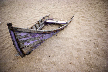 Color picture of an abandoned boat stuck in sand Stock Photo - 22880272