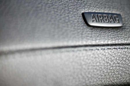 The word Airbag is written on a cars dashboard photo