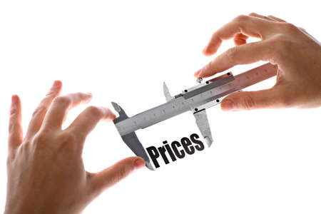 Close up shot of a caliper measuring the word 'Prices' photo