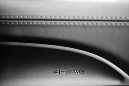 The word  Airbag  is written on a car photo
