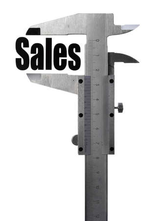 Close up shot of a caliper measuring the word  Sales  photo
