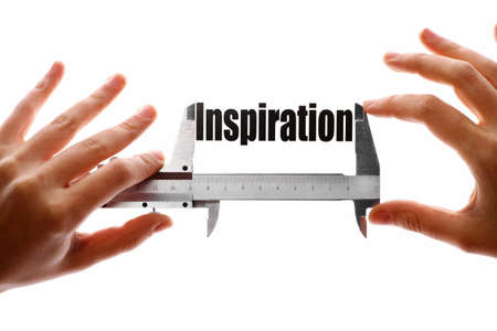 caliper: Two hands holding a caliper, measuring the word  Inspiration   Stock Photo