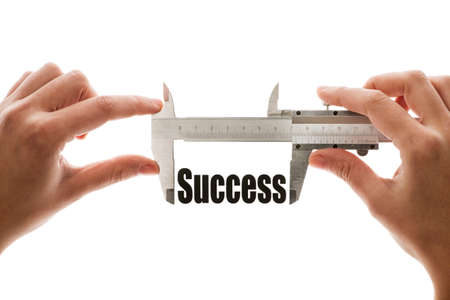 Close up shot of a caliper measuring the word  Success  photo