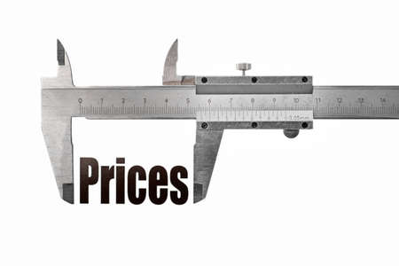 Close up shot of a caliper measuring the word Prices photo