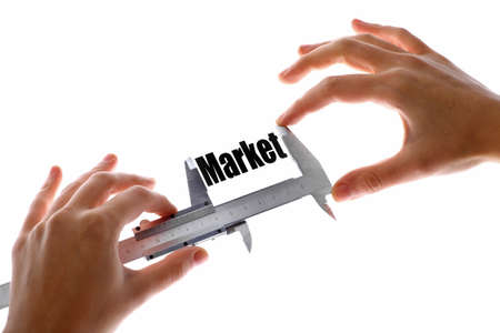Close up shot of a caliper measuring the word Market photo