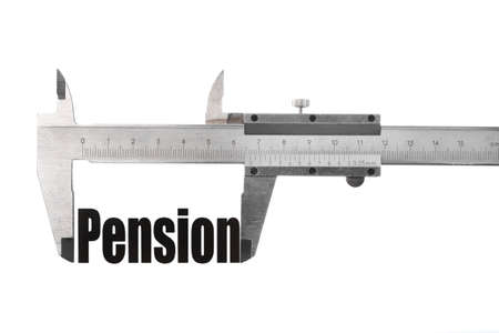 Close up shot of a caliper measuring the word Pension photo