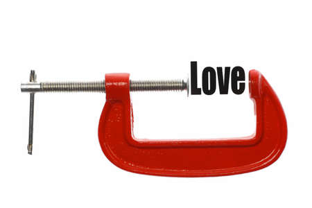 vice: Detail of a vice compressing the word Love.