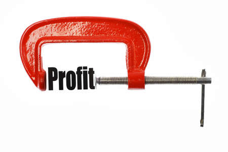 vice: The word Profit is compressed with a vice. Business metaphor. Stock Photo