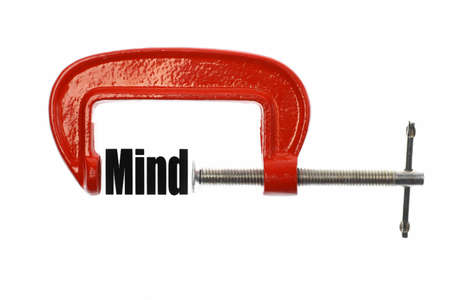 vice: The word Mind is compressed with a vice.  Stock Photo