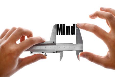 caliper: Two hands holding a caliper, measuring the word Mind.