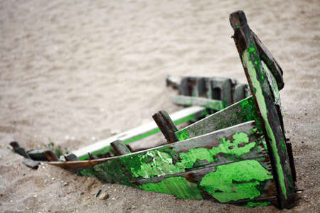 Color picture of an abandoned boat stuck in sand Stock Photo