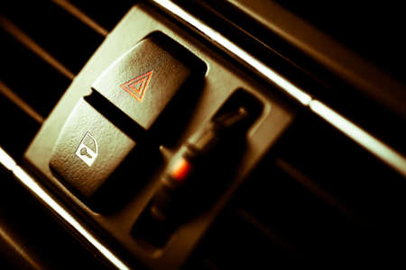 flashers: Detail of a warning button in a car