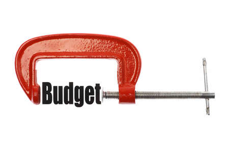 vice: The word Budget is compressed with a vice. Business metaphor.