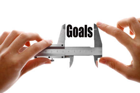 setting goals: Close up shot of a caliper measuring the word Goals Stock Photo