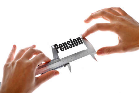 Close up shot of a caliper measuring the word Pension