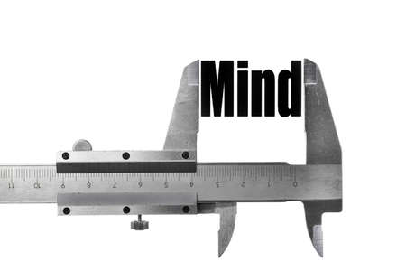 Picture of a caliper, measuring the word Mind. photo